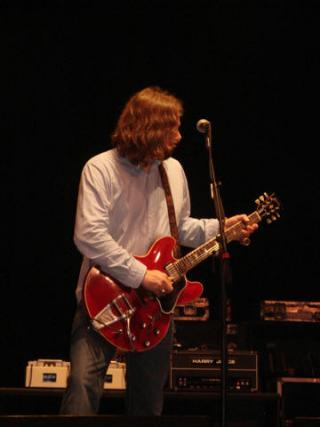 Rich Robinson on stage with a duo of TTEs.