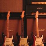 3 Vintage Strats and Assorted Marshall Amps.